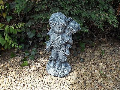 Piggyback boy and girl concrete garden ornament
