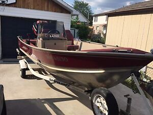 Lund Aluminum Fishing Boat, Motor, and Trailer