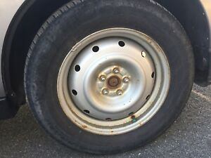 Set of 4 Subaru Rims & tires only 150$