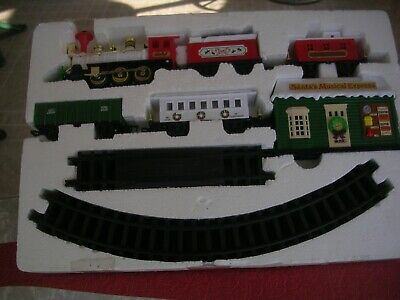 VINTAGE 1990s NEW BRIGHT CHRISTMAS SANTA'S MUSICAL EXPRESS TRAIN 22 PIECE SET-WO