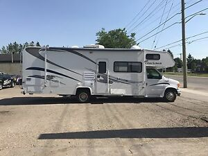 2003 FORD MOTORHOME WITH 2 TIP OUTS AND ONLY 16000 MILES