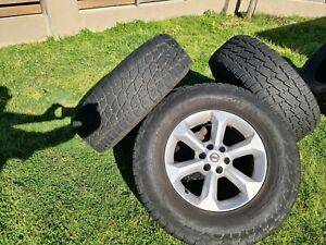 NITTO Terra Grappler tyres and Navara D40 rims (will separate)