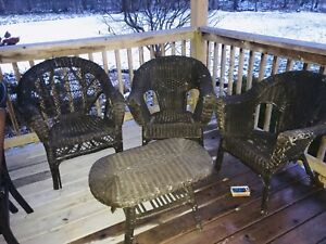 3 wicker chairs and wicker table.