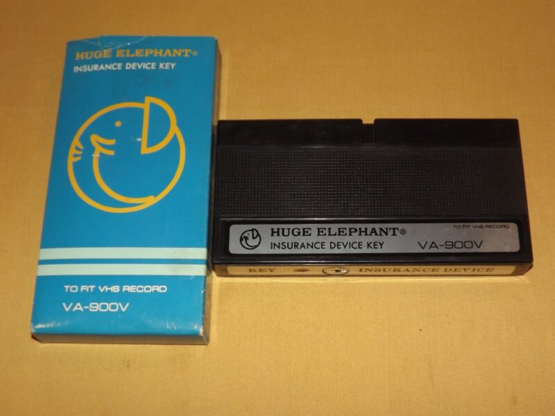 VINTAGE HUGE ELEPHANT INSURANCE DEVICE KEY LOCKS UP VHS VCR PLAYER
