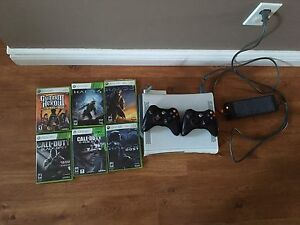 Selling 2 Xbox 360's with games and 2 controllers! Great buy!