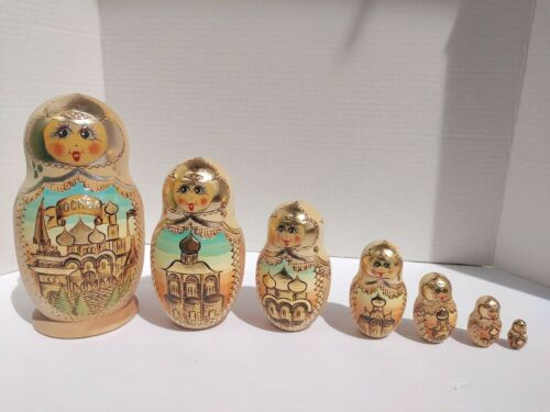 Vintage Christmas 7pc wood  Russian Mockba City Gold Nesting Dolls wood  Wooden