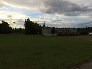 Mobile home with garage and acreage!