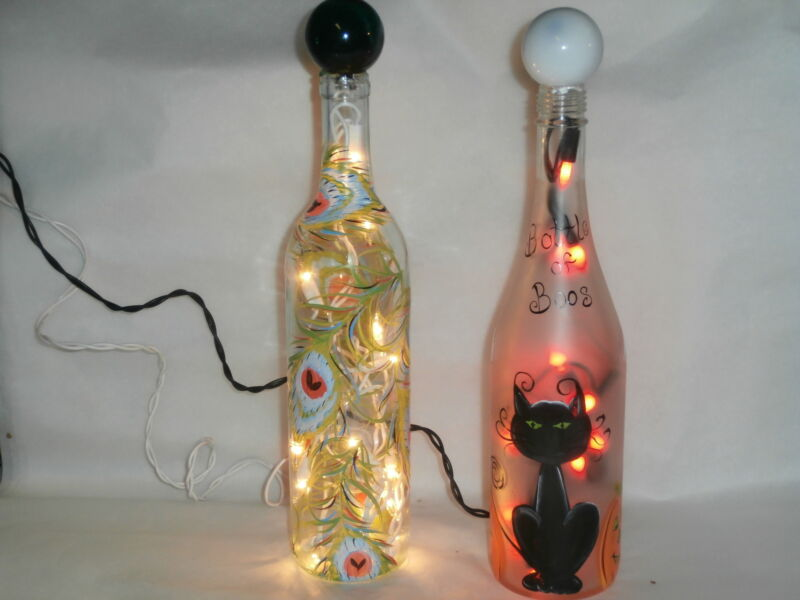 HAND PAINTED LIGHTED BOTTLE IN  FUN BOTTLE OF BOOS HALLOWEEN DESIGN. LIGHTED