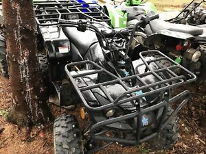 Kids four wheeler for sale or trad