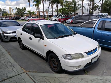Price drop -- Mazda 323 ---- Manual and Cold Aircon