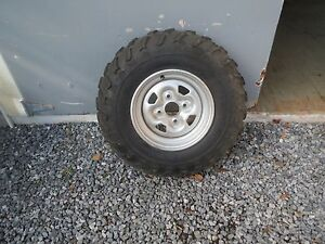 Four new  Tires And Rims for 700 Grizzly