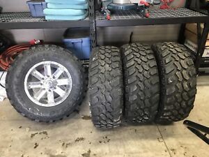 "Set of brand new 35"" tires balanced on 18"" 8 bolt rims"