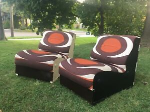Delivery available - pair of mid century lounge chairs