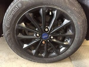 WANTED BLACK 15 INCH FORD FOCUS 4 BOLT RIMS