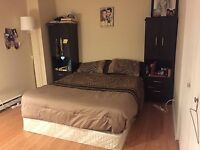King sized bed with a box spring and a headboard