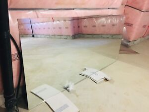 Large and single vanity frameless mirror.