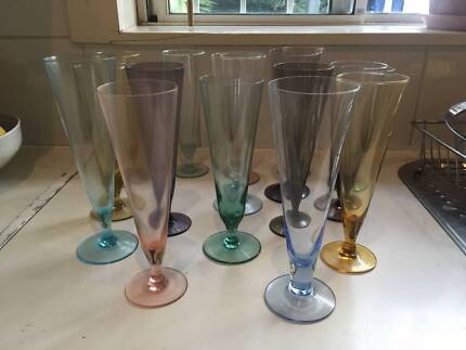 Assorted coloured glass flutes