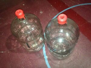 Two glass carboys