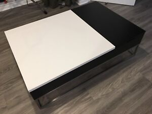 Modern coffee table with storage and lift