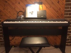 Electronic piano with accessories.