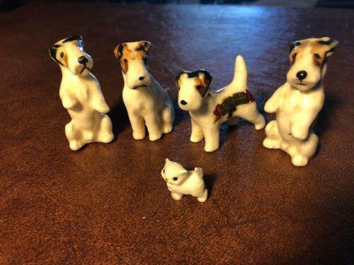 4 fox terrier figures plus worlds cutest kitten