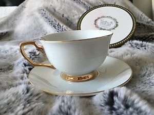 CRISTINA RE COLLECTABLE 24ct GOLD & IVORY PORCELAIN TEA CUP AND SAUCER Bronte Eastern Suburbs Preview