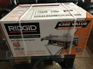 "Rigid 7"" inch table top wet Tile Saw with Stand ."