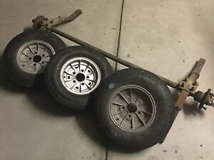 3 boat trailer wheels, axle, hubs, springs and bearing buddies Albury Albury Area Preview