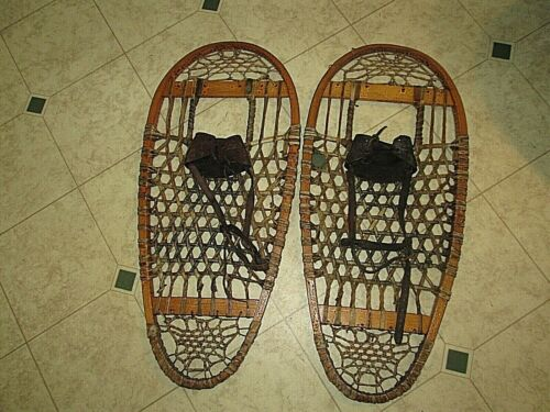 Vintage pair of wooden snowshoes  ( bear paw )