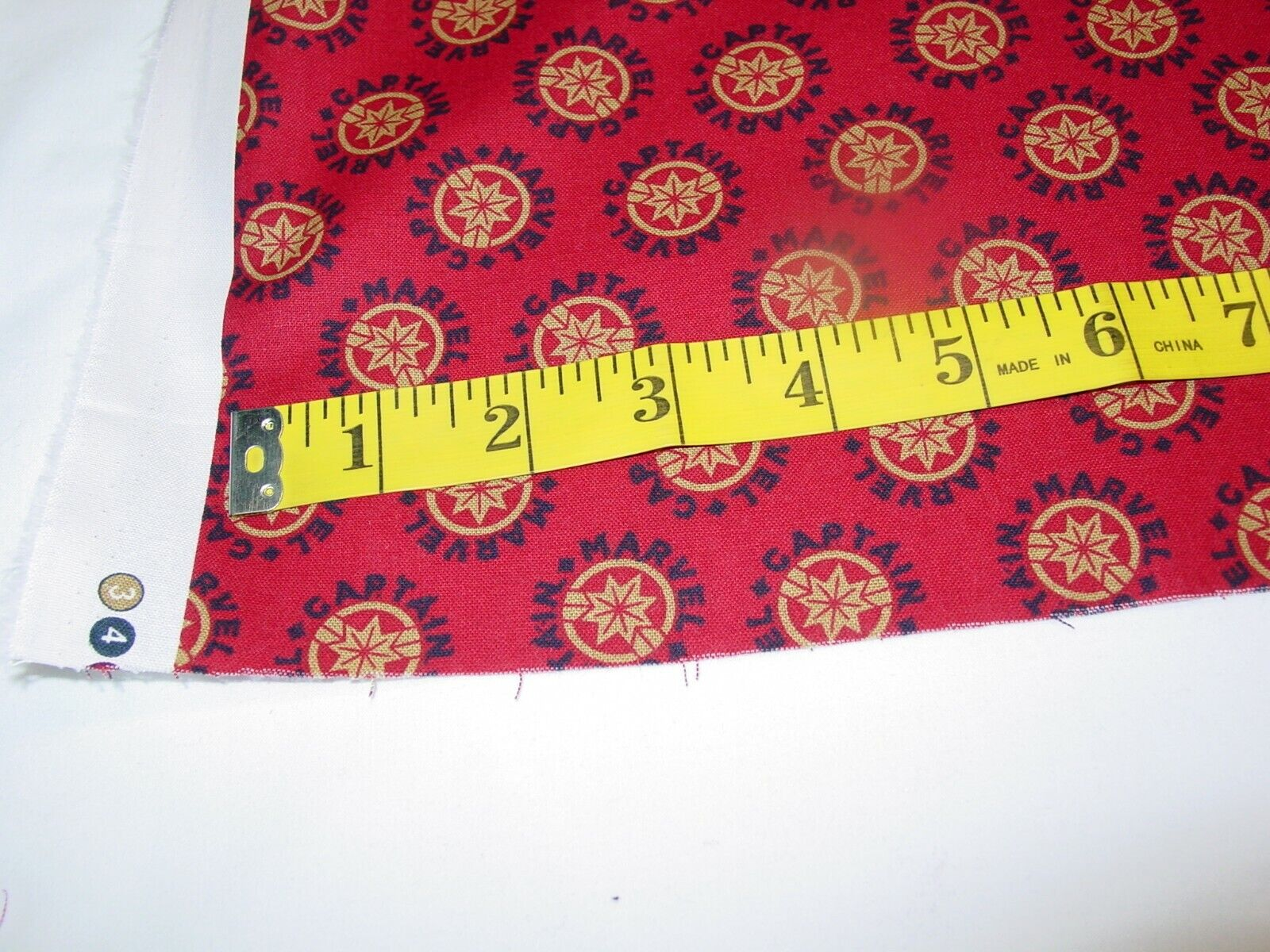 CAPTAIN MARVEL LOGO RED 100 COTTON FABRIC REMNANT LENGHT 33 X WIDTH 42  - $10.50