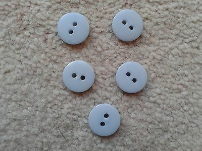 set of light grey buttons used but in good condition