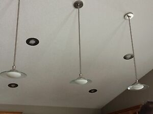 3 pendant lights and 4 bulb chandelier