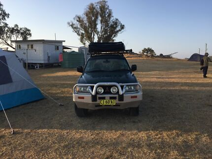 mitsubishi Challenger with rooftop Tent.