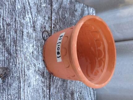 Plastic pot -terracotta coloured