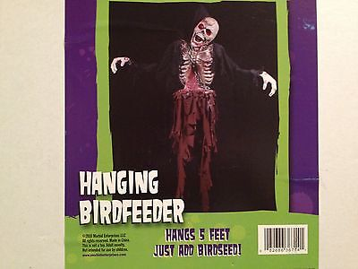 HAUNTED Bloody ZOMBIE SKELETON Corpse w/ Chains Hanging BIRD FEEDER PROP