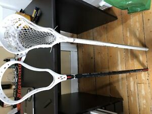 Two evo lacrosse heads. One under armour and one STX shaft