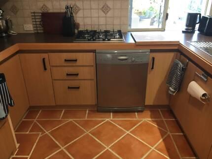 Large semi-U shaped wood kitchen Mindarie
