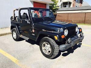1999 Jeep TJ 4.0 Litres peux prendre échange de même valeur