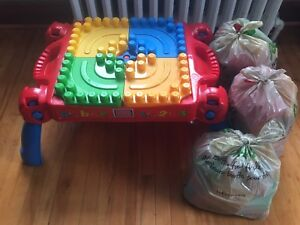 Mega blocks table with 3 bags of assorted blocks