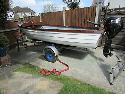 13 ft fishing boat trailer and Suzuki 8h/p electric start and manual start