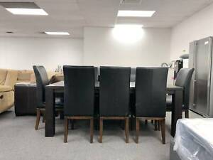 CLEARANCE SALE - 9 pcs dining table and leather chairs