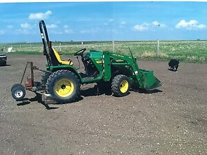 Reduced 4110 John Deere with loader, mower and attachments
