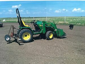 4110 John Deere with loader, mower and other attachments