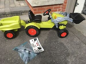 Child's ride on toy tractor front loader toy