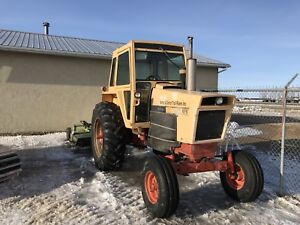 Case 870 and Schulte 6 foot mower
