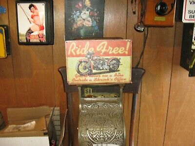Quick access hidden gun safe disguised as vintage sign diversion safe