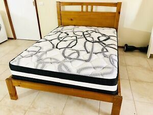 Wooden double bed and pillow top mattress, near new