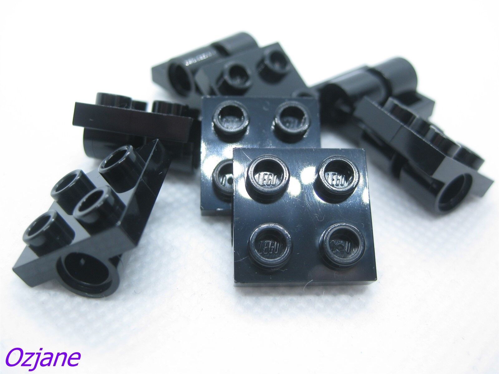 Modified 2 x 2 with Pin Holes LEGO 2817 Plate Black