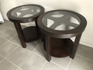Two dark brown round end tables