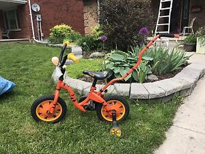 Tigger bike with training wheels and push bar